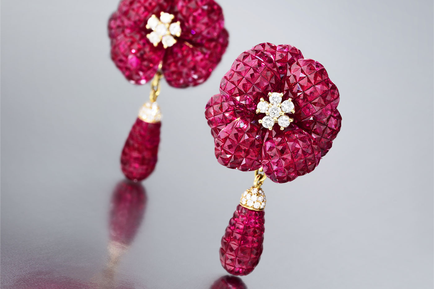 Invisibly set ruby earrings