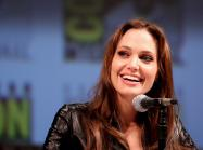Angelina Jolie sits at a comic con pannel