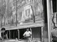 Men work on move backdrop, black and white image