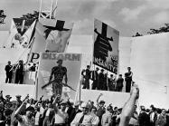 DAVID SEYMOUR black and white photograph of a crowd of people with their fists raised in the air