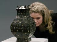 Expert looks at bronze vessel