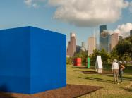 large colorful Carmen Herrera sculptures in a city park