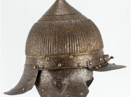 metal helmet with front and back bills, ear flaps and pointed top