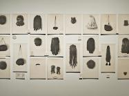 Lorna Simpson art installation of 20 images of wigs hung on a wall