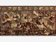 Folding screen, dark burgundy and intricately decorated to show a courtyard with Chinese structures and pavilions and garden features wit people mingling about.