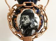 detail of Roberto Lugo ceramic vase with a portrait of Lil Wayne