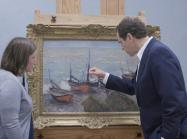 two museum workers study monet up close