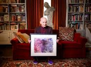 "John Waters at home with his ""monkey masterpiece."""