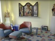 Room with renaissance altarpiece, renaissance sculpture, and modern furniture