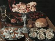 Dutch still life of a table top with oysters, bread and other foods