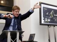 Sotheby's auctioneer Adrian Biddell gesticulates as he takes bids