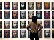 A wall of 32 woven portraits