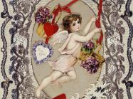A cupid figure is framed by ornate, organic artwork