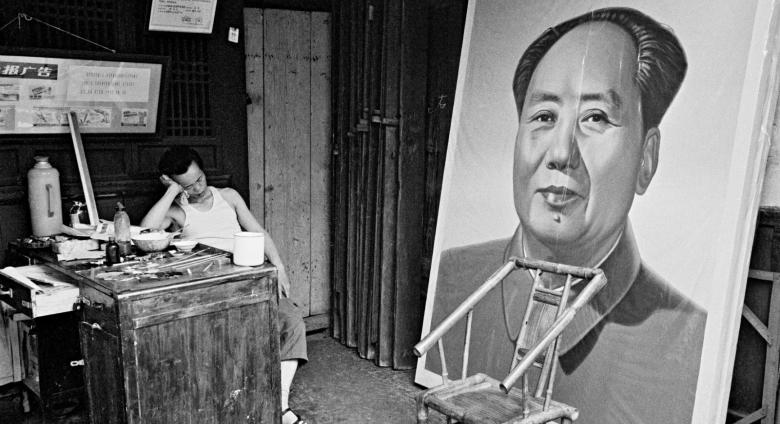 A painter naps at a craft art store specializing in ideological portraits, Chengdu, Sichuan province, 1980.