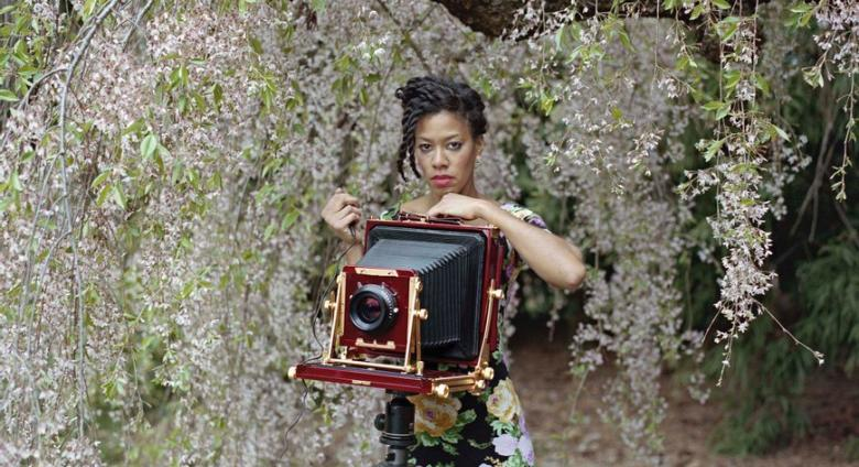 photo of Deana Lawson with a large-format camera