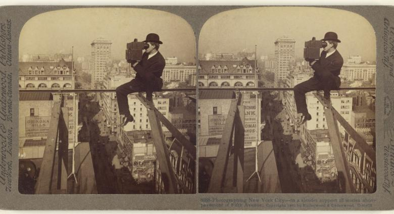 Underwood & Underwood (American, 1881 - 1940s), Photographing New York City - on a slender support 18 stories above pavement of Fifth Avenue., 1905. Gelatin silver print.