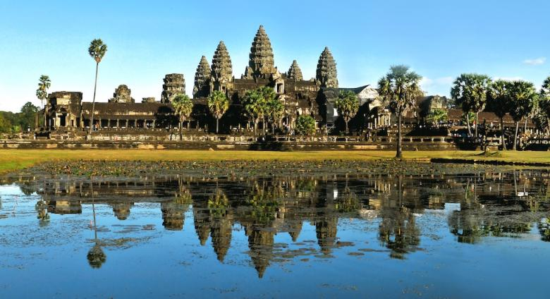 Angkor Wat temple makes up skyline beyond body of water