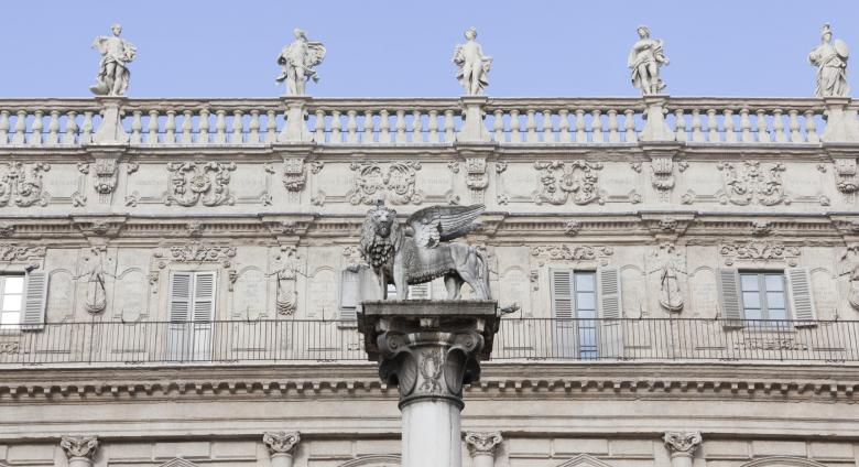 Facade of the Palazzo Maffei, a lion atop a pillar