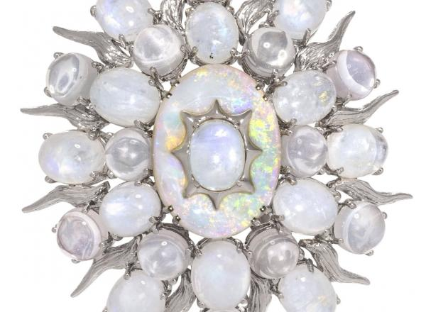 moonstone brooch in the shape of an oval with star points