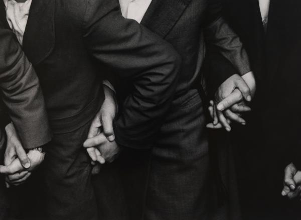 Ken Heyman black and white photograph of four sets of hands holding eachother