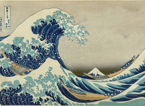 colored woodblock print of a giant wave crashing at sea with small boats beneath it