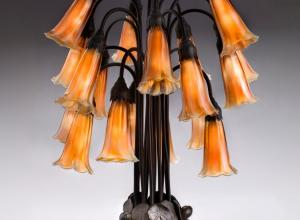 Tiffany Glass & Decorating Company, Eighteen-light Lily Table Lamp, prior to 1902, bronze, blown glass.