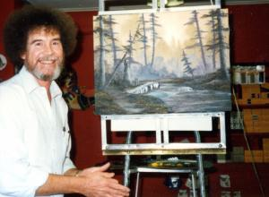 5. Bob Ross- Happy Accidents, Betrayal & Greed - Production Still of Bob Ross with a finished painting.
