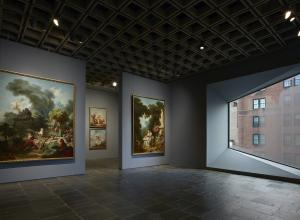 Four grand panels of Fragonard's series The Progress of Love are shown together at Frick Madison in a gallery illuminated by one of Marcel Breuer's trapezoidal windows. This view shows two of the 1771–72 paintings, with two later overdoors visible in the next gallery.