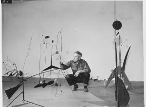 Publicity photograph of Calder during the installation of Alexander Calder. black and white