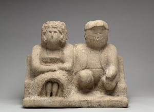 Edmonson, Bess and Joe, 1930-40. A a simple, stone sculpture of a couple sitting together, looking ahead.