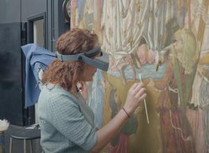 Conservator works on altarpiece