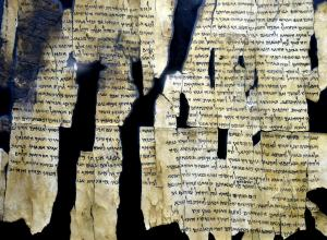 dead sea scrolls: fragments of ancient paper with text