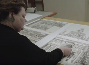conservator studies several prints