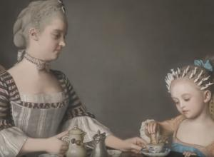 mother and daughter take tea