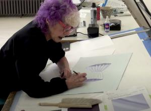 Judy Chicago in her studio working on paper