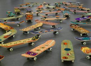 Mounir Fatmi, Maximum Sensation, 2010. Fifty skateboards, plastic, metal, textile, 5 × 8 × 31 11/16 in. (12.7 × 20.3 ×80.5 cm). Brooklyn Museum.