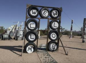 Welcome sign made of tires at the Purifoy Outdoor museum