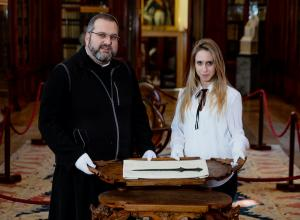 Father Serafino Jamourlian and Vittoria Dall'Armellina with the sword