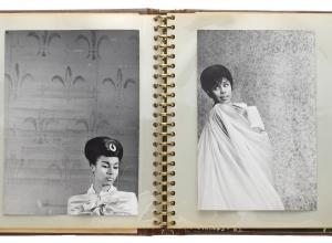 A photographic archive pertaining to the 1962 Broadway play, No Strings, a spiral notebook opened, each page has a photo of actress Diahann Carroll