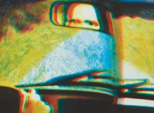 printed image of eyes in a rearview mirror