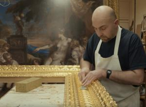 craftsman works on masterpiece frame