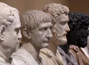 a line of of marble busts receding into the distance.