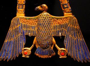 egyptian pectoral amulet in the shape of a vulture, made in gold with lapis lazuli inlay