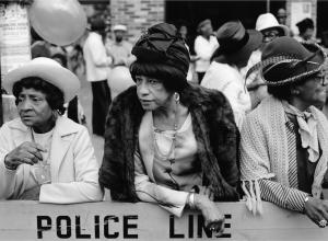 Dawoud Bey, Three Women at a Parade, Harlem, NY, from Harlem, U.S.A., 1978. Gelatin silver print (printed 2019). 11 x 14 in. Frame: 16 3/8 x 20 5/8 x 1 1/2 in.