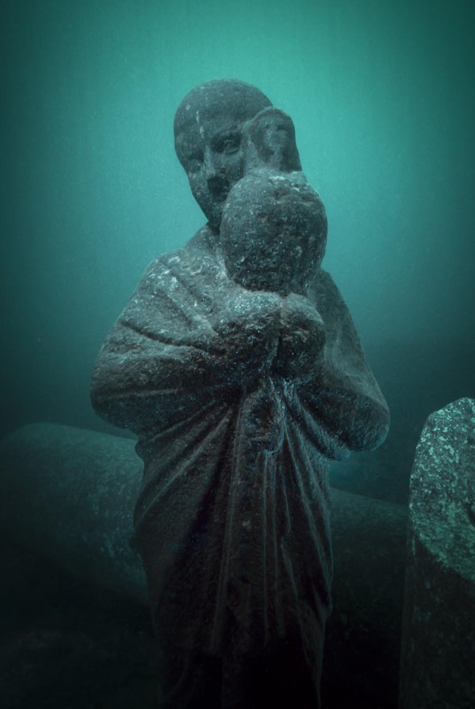 Priest holding an Osiris-Canopus in veiled hands, Alexandria, 1st century BC-2nd century AD