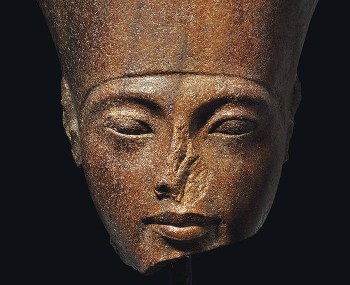 An Egyptian Brown Quartzite Head of the God Amen with features of the Pharaoh Tutankhamen. New Kingdom, 18th Dynasty, Reign of Tutankhamen, circa 1333-1323 B.C.