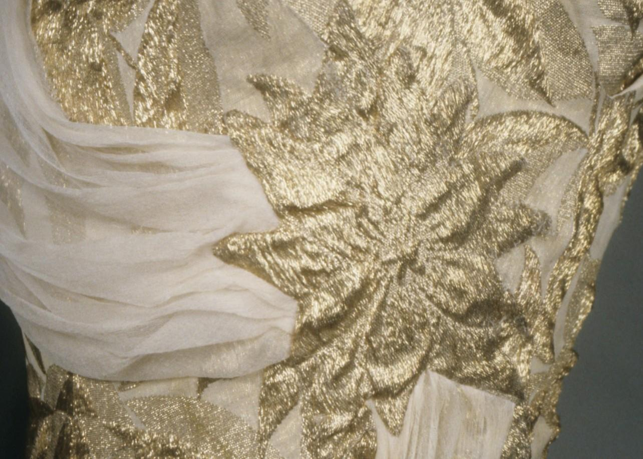 Gold brocade evening dress with beige silk chiffon scarf