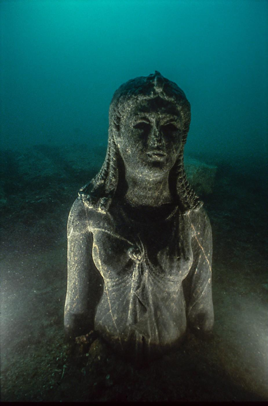 Bust of the black stone queen set up underwater on site, Heracleion, Egypt