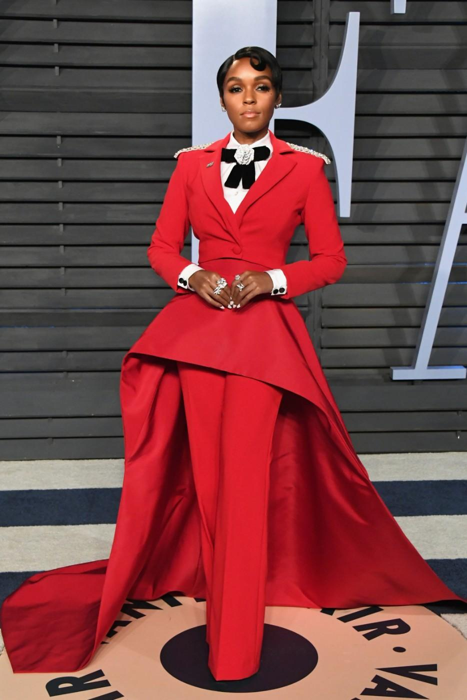 Janelle Monáe in a Christian Siriano red evening suit, shirt and accessories at the 2018 Vanity Fair Oscar Party