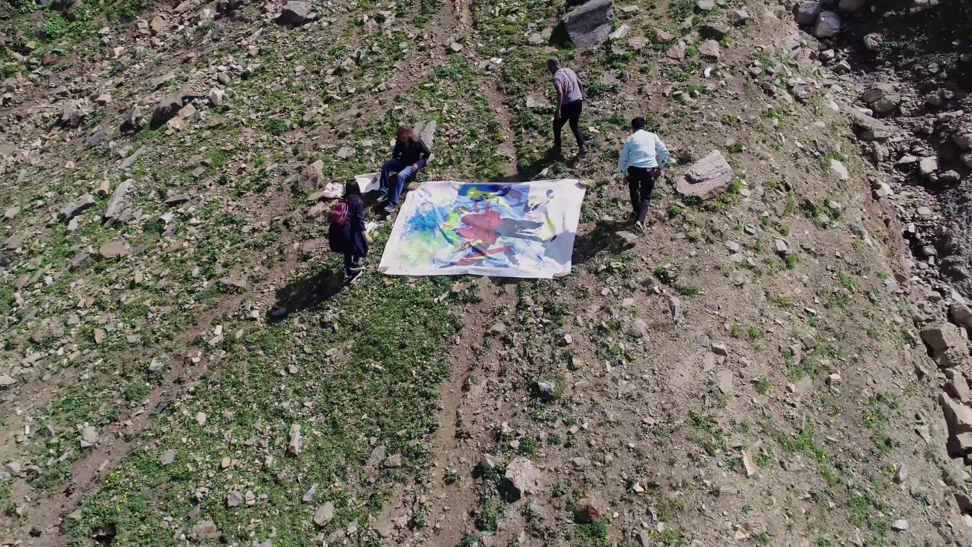 Nasser Azam painting on the mountain, August 2018